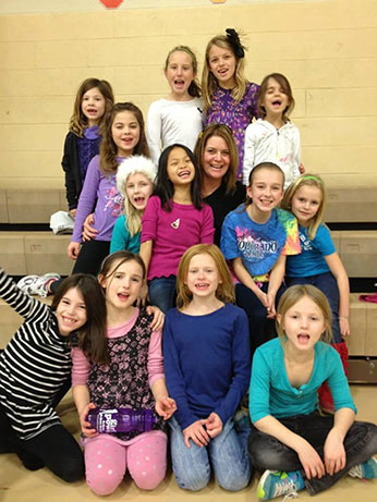 Erin Mahoney with strong girls at a Girl Power Go class